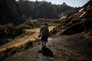 A guajero arrives at 'The Mine,' one of Guatemala City's biggest dumps, to search for scrap