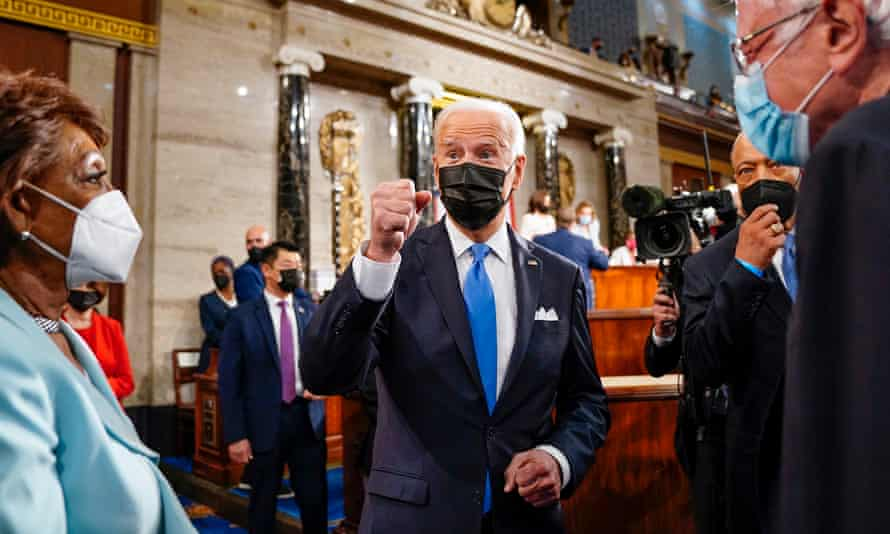 Joe Biden leaves the House chamber after delivering a speech to Congress on 28 April.