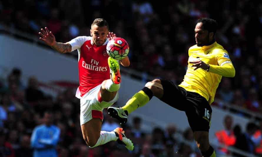Arsenal's Jack Wilshere, left, challenges for the ball with Joleon Lescott of Aston Villa in their 4-0 defeat at the Emirates.