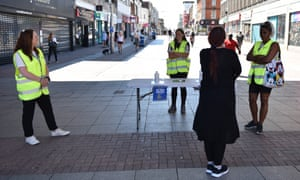 Volunteers work on a hand sanitiser station along the high street in Southend-on-Sea, in Essex, on 15 June