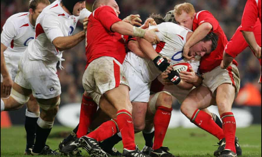 Former England rugby player Steve Thompson, who has revealed that he has early-onset dementia, is tackled during a six nations game against Wales.
