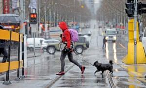 Lone commuter crosses road in Melbourne