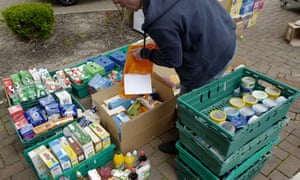 Volunteers operate a food drop to support local food banks in Saddleworth, Greater Manchester.