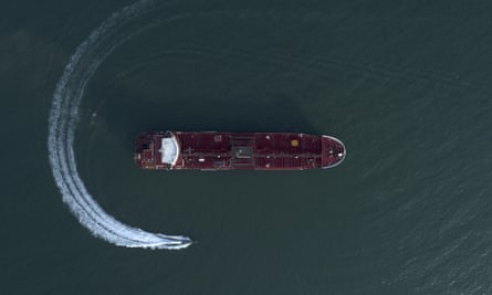 Aerial view of speedboat of Iran's Revolutionary Guard circling the British-flagged oil tanker Stena Impero which was seized in the strait of Hormuz and exacerbated the crisis.