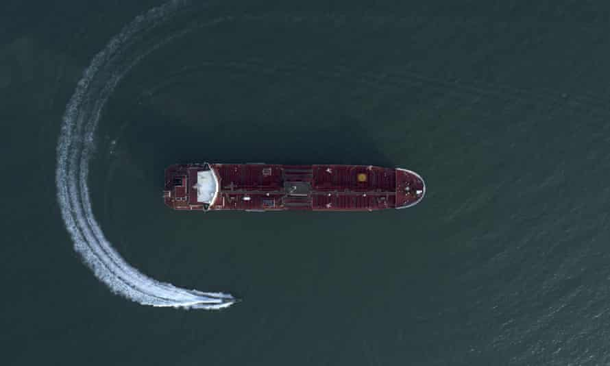 An aerial view shows a speedboat of Iran's Revolutionary Guard moving around the British-flagged oil tanker Stena Impero.