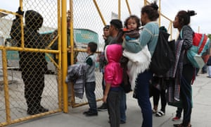 Migrants from Honduras, arrive at a migrant hostel hoping to be taken in as they wait to apply for asylum in to the United States in Piedras Negras, Mexico.