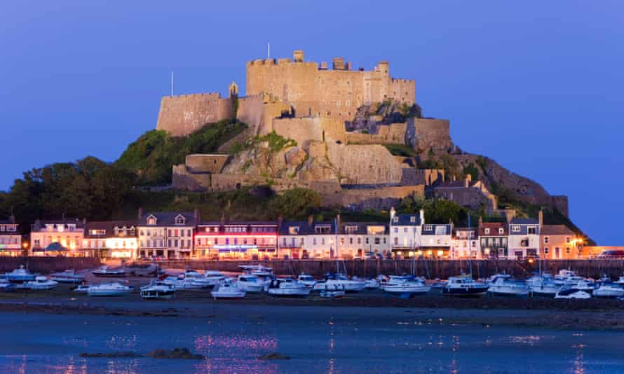 Mount Orgueil Castle overlooking Grouville Bay in Gorey, Jersey. The island looks prosperous but is going broke.