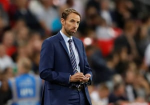 Southgate takes some notes for his half time team talk.