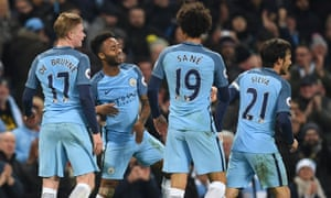 Raheem Sterling (second left) celebrates with Manchester City teammates Kevin De Bruyne, Leroy Sané and David Silva in 2016.