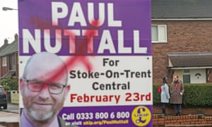 A defaced Ukip campaign poster in a garden as Labour's candidate Gareth Snell campaigns on the doorsteps of homes in Bentilee.