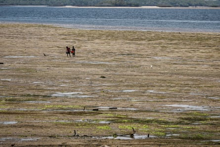 Young boys walk on the beach of Lamu island, near the proposed site for the coal plant.