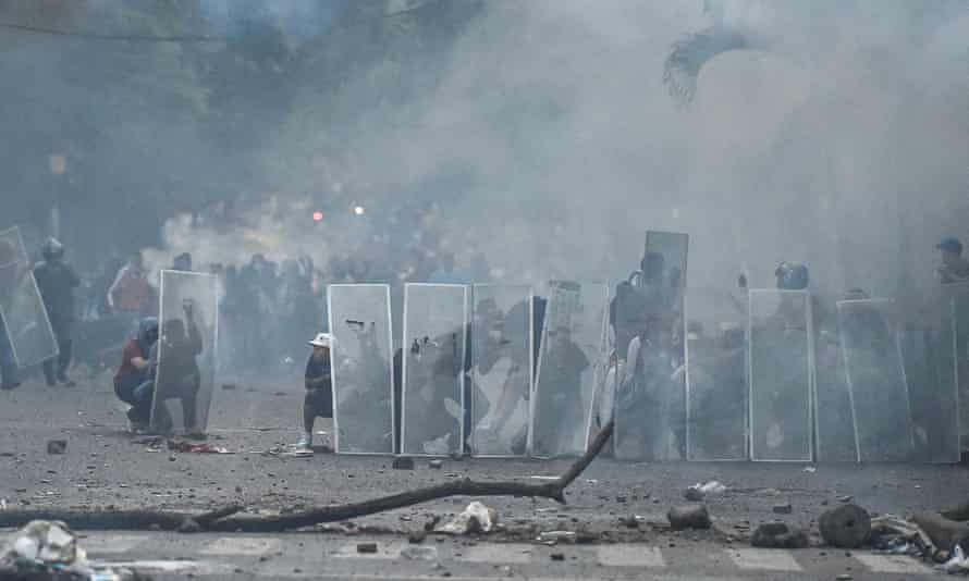 Demonstrators took refuge behind makeshift shields in Cali, Colombia, on April 30.
