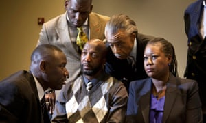 Sybrina Fulton and Tracy Martin, the parents of Trayvon Martin, talk to family lawyer Benjamin Crump and the Rev Al Sharpton on 11 April 2012.