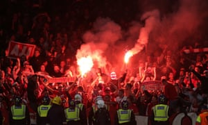 Flares are set off in the away end by Cologne fans.