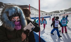 Skiers at the new Thaiwoo ski resort, which will host events at the 2022 Olympics.