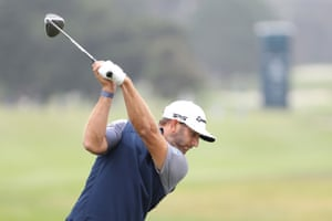 Dustin Johnson plays his shot from the first tee.