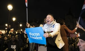 Macron supporters celebrate victory in Paris.