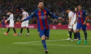 Lionel Messi celebrates after scoring one of his two goals for Barcelona against Sevilla.