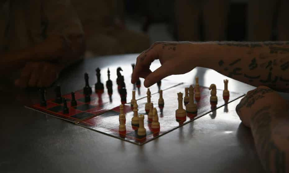 Inmates play chess at a prison in the US