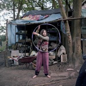 Lisa practices her hula hoop skills by the longhouse