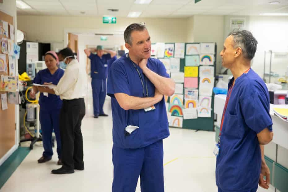 """Roger Townsend, a clinical lead in ITU, in discussion with a colleague. He says: """"I think we've come through the test – I'm not sure ever we'll be the same again."""""""