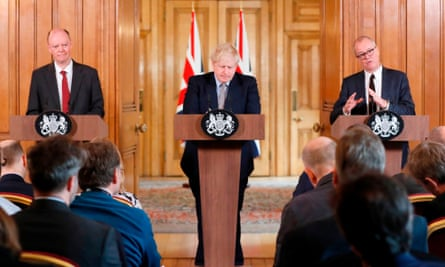 Boris Johnson flanked by chief medical officer to the government, Chris Whitty, left, and the chief scientific adviser, Sir Patrick Vallance, right.