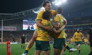 Adam Ashley-Cooper, Matt Toomua and Israel Folau of the Wallabies celebrate after the former's try.