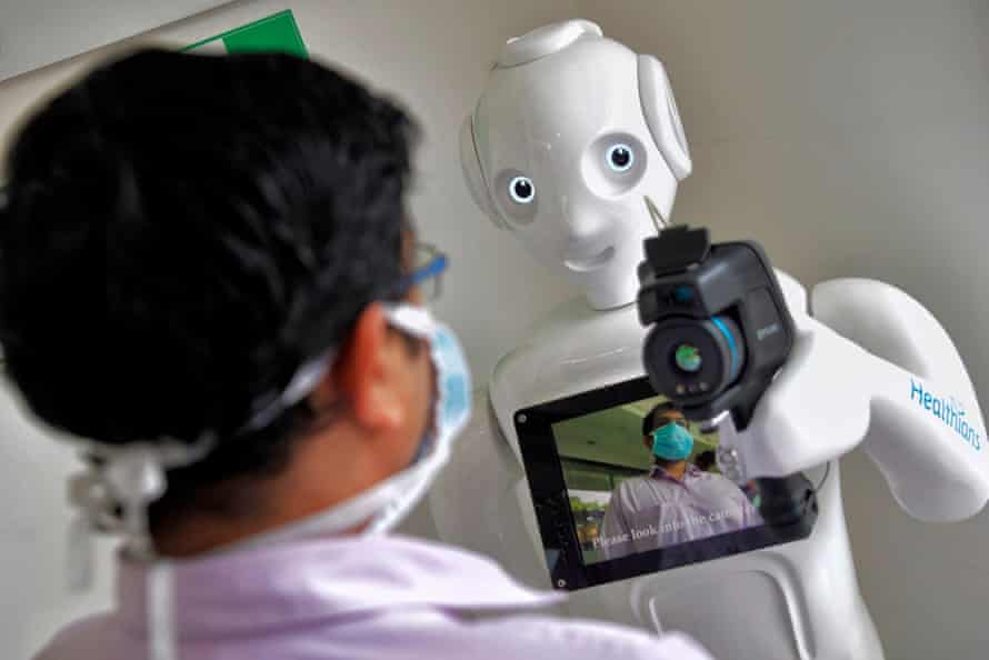 Mitra is equipped with a thermal camera to screen patients before directing them at Fortis hospital in Bengaluru.