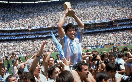 Maradona holds the World Cup trophy after Argentina's defeat of West Germany in the final in Mexico City in 1986.