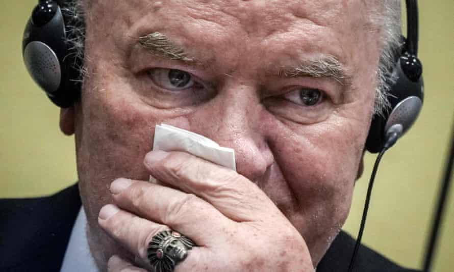 Ratko Mladic wipes his face