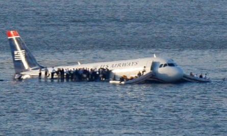 Passengers stand on the wings of the US Airways plane after it ditched in the Hudson.