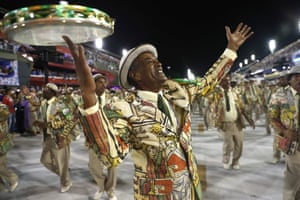 Performers from the Mangueira samba school join the parade