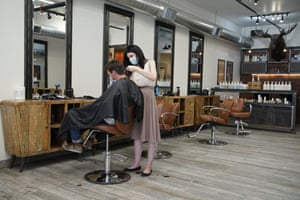 Eden Walton cuts the hair of M Sibert at Makeshift Union Cutting & Grooming on 9 May in Las Vegas.