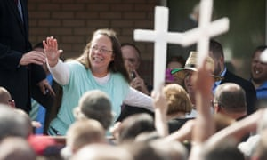 The Rowan County clerk, Kim Davis, who has refused to issue marriage licenses to same-sex couples, waves to supporters at a rally in Grayson, Kentucky.