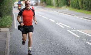 Running one of many marathons for Sport Relief in July 2009.