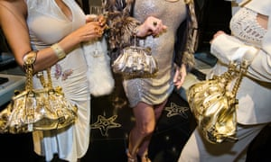Bags full of it: at a private opening at a Versace store in Beverly Hills.