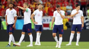 England's players await the restart. They don't look too pleased and nor should they.