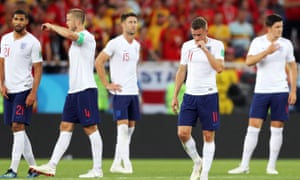 Jamie Vardy (second right) and the rest of the team look dejected after failing to test the Belgium goalkeeper in their group stage defeat in Kaliningrad.