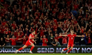 The stadium erupts after Wales' Connor Roberts (left) celebrates with David Brooks after scoring their fourth goal.