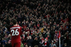 Andrew Robertson applauds the Liverpool fans as he is substituted.