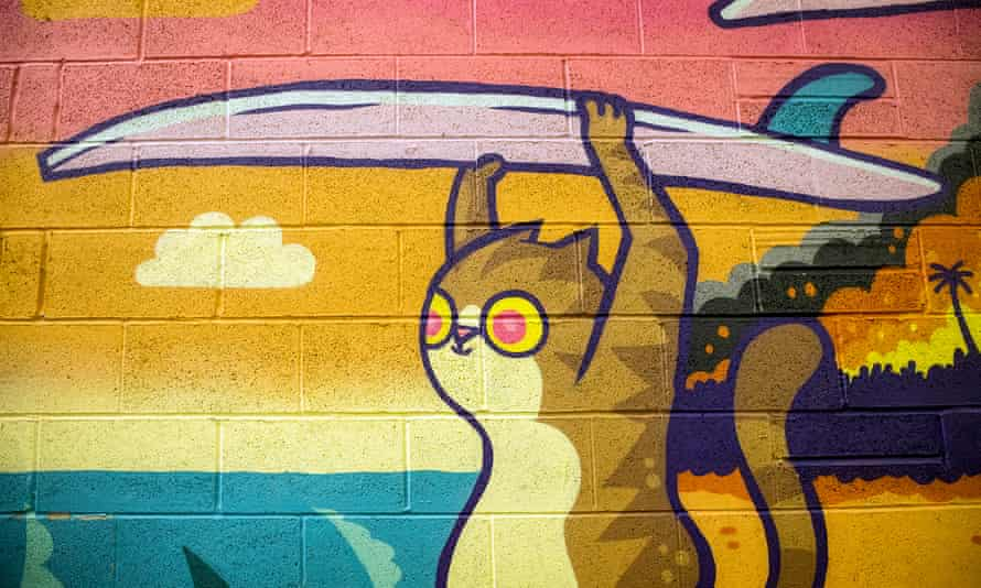 Cartoon mural of a cat holding a surfboard at Alphabet Brewery tap room, Manchester
