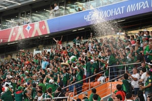 Fans of Mexico react in the stands when the score comes through from South Korea v Germany