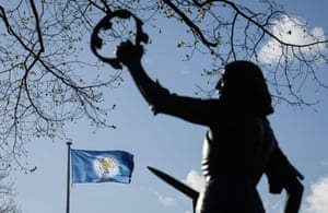 A statue of King Richard III is photographed as a Leicester City flag flies above the Cathedral.