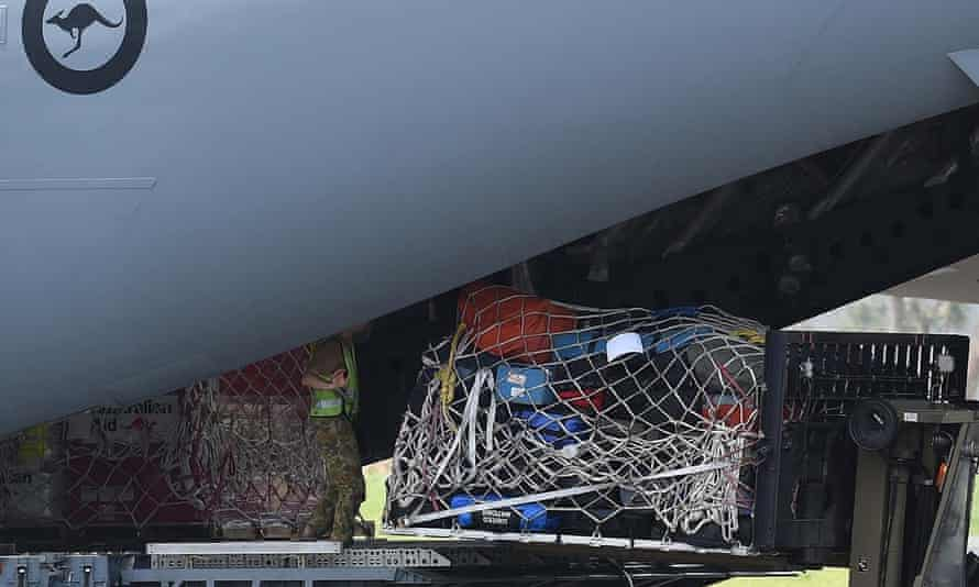 Australian aid supplies are unloaded from an aircraft