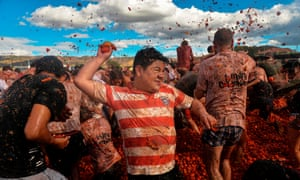 Participants take part in the 10th annual tomato fight festival, known as Tomatina.