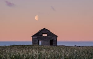 The moon rises on the old Mission House of Qikiqtaruk-Herschel,  a remote island in the Canadian Arctic. The abandoned building, now home to a seabird colony