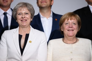 London, England Theresa May and German Chancellor Angela Merkel take part in the family photo during the Western Balkans Summit at Lancaster House