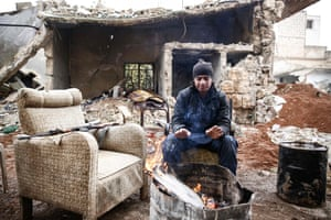 Aleppo, SyriaA Turkey-backed Syrian rebel fighter warms himself at a position near the city of al-Bab, on the border with Turkey