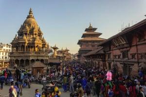 Crowd of people walking at shopping Street market at Patan Durbar Square on Tihar festival day, Patan Nepal.