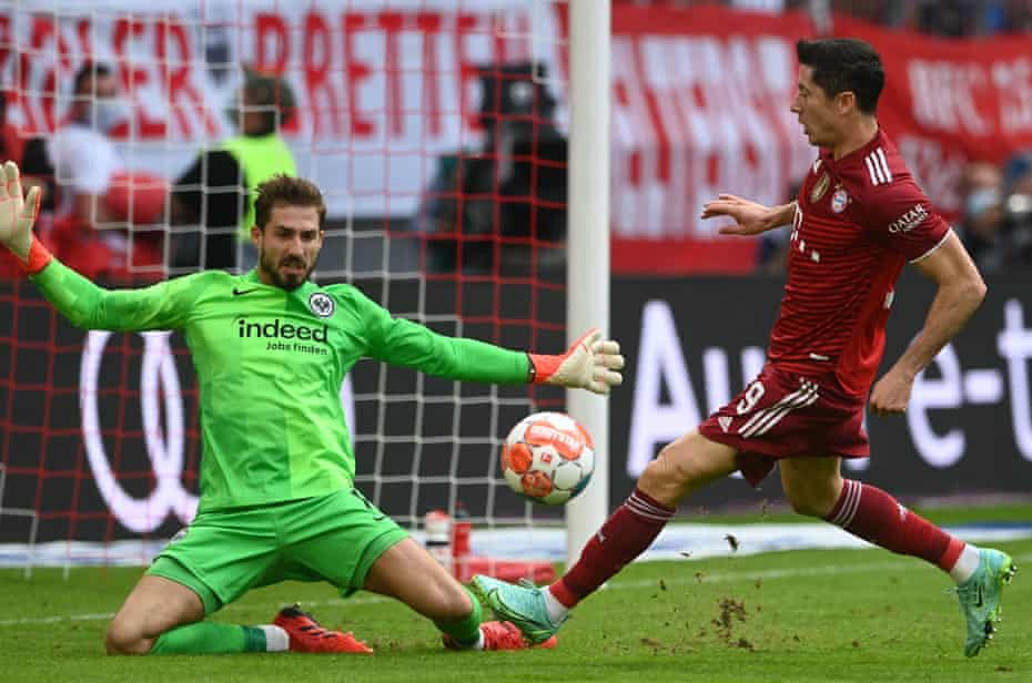 Kevin Trapp (left) spreads himself to deny Robert Lewandowski – one of a number of important saves he  made at the Allianz Arena.